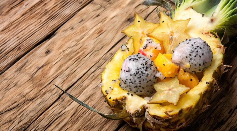 Pineapple with fruit salad inside